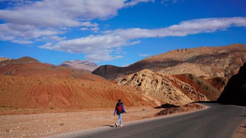 A child walks home from school through the mountains around Telouet Kasbah in Morocco.