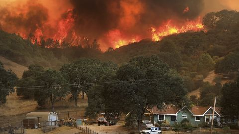 Flames from a wildfire advance down a hillside near Lakeport on August 2.