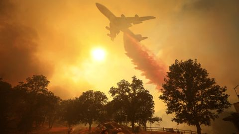 An airplane drops fire retardant in Lakeport on Thursday, August 2.