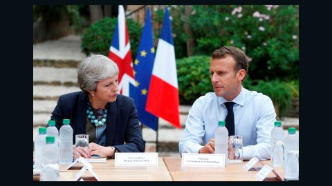 French President Emmanuel Macron (R) speaks with British Prime Minister Theresa May (L) during a meeting at Fort de Bregancon in Bormes-les-Mimosas, southern France on August 3, 2018. - May has cut short her holiday for the meeting at the French presidential summer retreat. (Photo by Sebastien NOGIER / POOL / AFP) (Photo credit should read SEBASTIEN NOGIER/AFP/Getty Images)