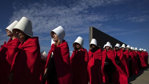"""Activists in favor of legalizing abortion march in Buenos Aires dressed as women from Margaret Atwood's """"The Handmaid's Tale."""""""