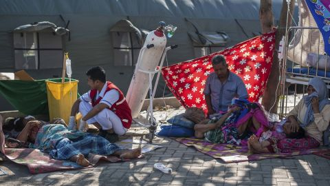 A paramedic attends to earthquake victims at a makeshift hospital on Lombok Island, Indonesia, on Monday.