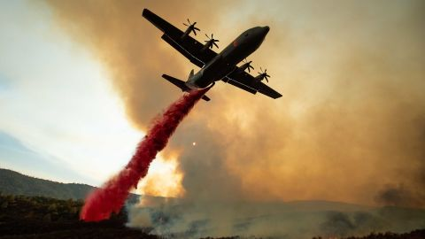 TOPSHOT - An air tanker drops retardant on the Ranch Fire, part of the Mendocino Complex Fire, burning along High Valley Rd near Clearlake Oaks, California, on August 5, 2018. - Several thousand people have been evacuated as various fires swept across the state, although some have been given permission in recent days to return to their homes. (Photo by NOAH BERGER / AFP)        (Photo credit should read NOAH BERGER/AFP/Getty Images)