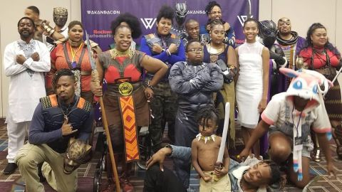 Cosplayers dressed in their Wakandan finest pose for a group photo at the first-ever WakandaCon in Chicago, Illinois.