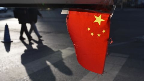 A Chinese national flag hangs from a barrier in a car park in Beijing on January 18, 2018. China's economy grew a forecast-beating 6.9 percent in 2017, picking up steam for the first time since 2010 despite its battles against a massive debt and polluting factories, official data showed on January 18. / AFP PHOTO / Greg Baker        (Photo credit should read GREG BAKER/AFP/Getty Images)