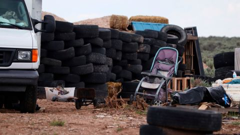 Stacks of tires and other debris appear at the filthy compound last week in Amalia, New Mexico.