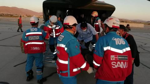Medics transport food-poisoning victims to a hospital in Lima.