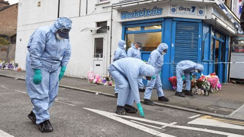 Forensic officers search Chalgrove Road in Tottenham, north London, where a 17-year-old girl died after she was shot on April 3, 2018.
