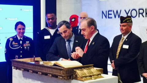A representatives from Marvel and representatives from several veterans groups attend an event at the NYSE on November 7, 2017.