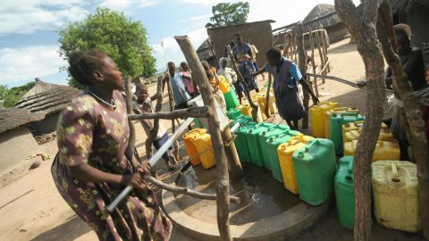 A woman pumps water from a borehole in an internally displaced people's (IDP) camp in Uganda.