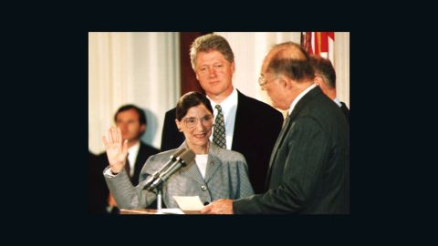 WASHINGTON, DC - AUGUST 10:  Chief Justice of the U.S. Supreme Court William Rehnquist (R) administers the oath of office to newly-appointed U.S. Supreme Court Justice Ruth Bader Ginsburg (L) as U.S. President Bill Clinton looks on 10 August 1993. Ginsburg is the 107th Supreme Court justice and the second woman to serve on the high court.  (Photo credit should read KORT DUCE/AFP/Getty Images)