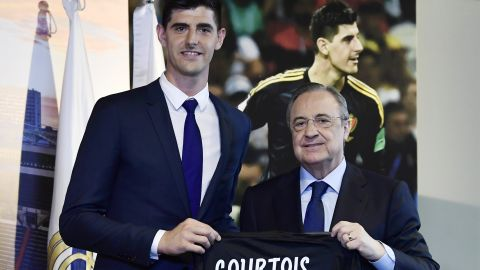 After four years and two Premier League titles with Chelsea, Belgian keeper Thibaut Courtois is off to Real Madrid on a six-year contract. Here he stands with Real Madrid president Florentino Perez during his presentation.