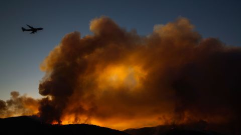 A supertanker jet flies above the Holy Fire near Lake Elsinore on August 7.