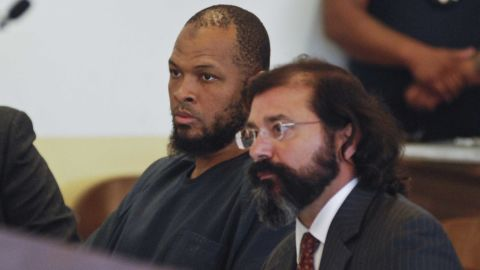 Siraj Ibn Wahhaj, left, sits next to public defense attorney Aleks Kostich at a first appearance in New Mexico state district court.