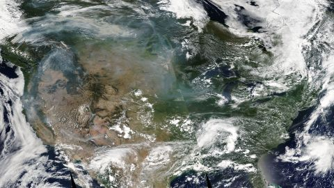 A satellite image taken Thursday shows that the western wildfire smoke spreading toward the East Coast of the US in the upper atmosphere as the forecast model predicted.