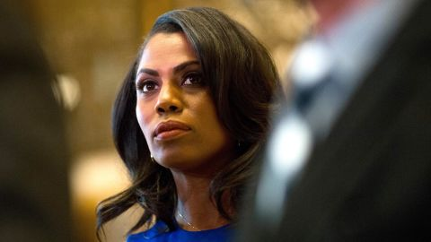 Omarosa Manigault, a staffer for US President-elect Donald Trump, listens as Martin Luther King III speaks to the media after meeting with the President-elect at Trump Tower in New York City on January 16, 2017.  / AFP / DOMINICK REUTER        (Photo credit should read DOMINICK REUTER/AFP/Getty Images)
