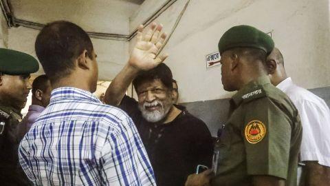 Shahidul Alam, 63, gestures in a hospital in Dhaka on Wednesday.