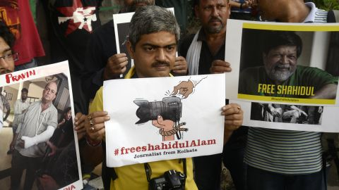 Indian journalist hold placards and take part in a silent demonstration Wednesday to protest against attack on journalists and the arrest of renowned Bangladeshi photographer and activist Shahidul Alam in Dhaka.