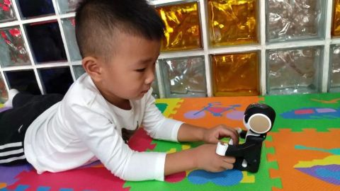 RoBoHon, a robot powered by AI system customized for children, has been used in a children's hospital in Harbin for young people with autism.