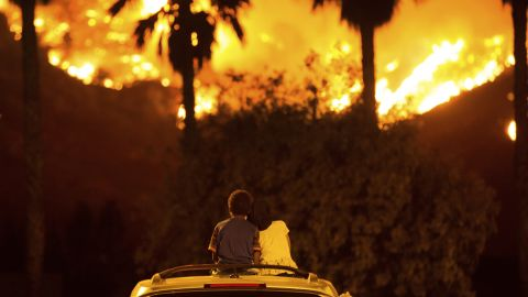 King Bass, 6, and his 5-year-old sister, Princess, watch the Holy Fire burn from the top of their parents' car in Lake Elsinore on Thursday, August 9.
