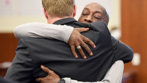 Johnson hugs one of his lawyers after the jury awarded him $289 million in damages.