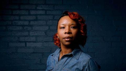 In this photo made Wednesday, April 27, 2016, Lezley McSpadden poses for a portrait in St. Louis. McSpadden was sitting in her car on a smoke break from her grocery store job on Aug. 9, 2014, when a friend told her someone had been shot near Canfield Apartments in Ferguson, Mo. After that her life crumbled learning her son, 18-year-old son Michael Brown, had been shot and killed by a police officer. (AP Photo/Jeff Roberson)