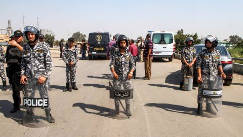 Egyptian police form a perimeter after a suicide bomber detonated an explosive belt after being denied entry to a Coptic Christian church in Mostorod on  August 11, 2018.