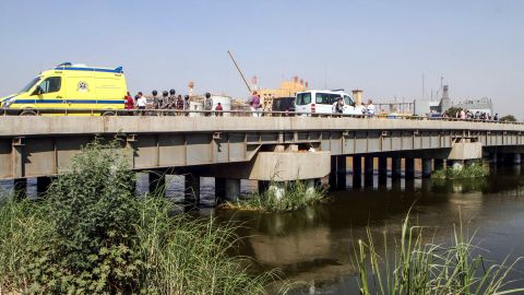 Egyptian police gather on a bridge over the Nile where a suicide bomber detonated an explosive belt after being denied entry to a Coptic Christian church.