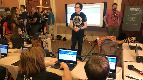 Children prepare to hack mock versions of state election websites at DEF CON on Friday. (Photo by Donie O'Sullivan/CNN)