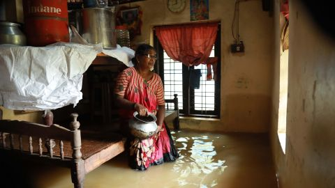 TOPSHOT - An Indian woman sits inside her houses immersed in flood waters in Ernakulam district of Kochi, in the Indian state of Kerala on August 10, 2018. - Flash floods have claimed at least 27 lives in the southern Indian state of Kerala, officials said on August 10, prompting the US to advise its citizens to stay away from the tourist hotspot. (Photo by - / AFP)        (Photo credit should read -/AFP/Getty Images)