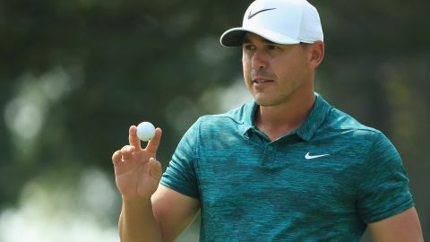 Brooks Koepka of the United States acknowledges the crowd after making a putt for birdie on the ninth green during his triumphant final round of the 2018 PGA Championship at Bellerive Country Club.