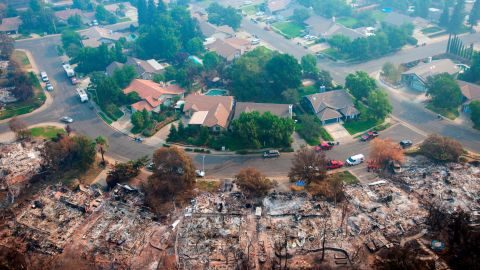 Homes destroyed by a wildfire in Redding, California are seen from an aerial view on Friday, August 10