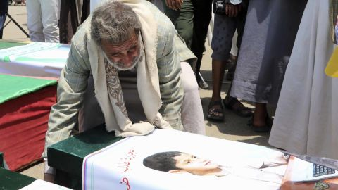 A Yemeni man mourns over a casket on August 13, 2018 during a mass funeral in the northern Yemeni city of  Saada, a stronghold of the Iran-backed Huthi rebels, for children killed in an air strike by the Saudi-led coalition last week. - At least 29 children were among those killed in the air raid on August 9 on a bus in a crowded market in Dahyan, Saada province, according to the International Committee of the Red Cross. (Photo by STRINGER / AFP)        (Photo credit should read STRINGER/AFP/Getty Images)