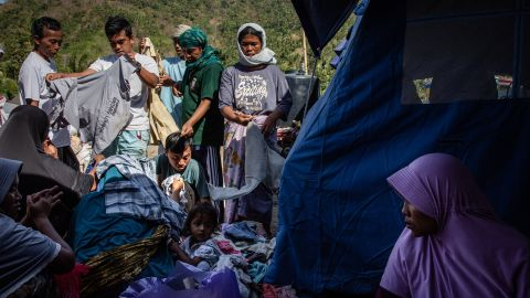 Villagers scramble for used clothing at temporary shelter in Pemenang in Lombok Island on August 12.