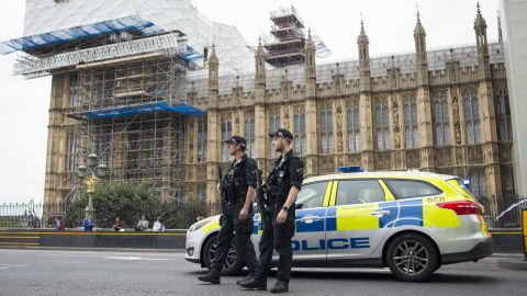 Police stand guard outside the Houses of Parliament following the incident.