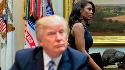 n this March 12, 2017 file photo, White House Director of communications for the Office of Public Liaison Omarosa Manigault, right, walks past President Donald Trump during a meeting on healthcare in the Roosevelt Room of the White House in Washington. (AP/Pablo Martinez Monsivais)