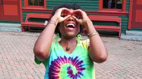 Laughter yoga students engage in playful excercise that promote laughter and wellness.