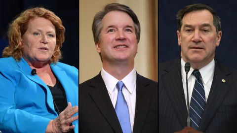 From left, North Dakota Democratic Sen. Heidi Heitkamp, President Donald Trump's nominee to the Supreme Court Brett Kavanaugh and Indiana Democratic Sen. Joe Donnelly.
