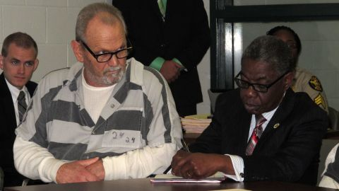 Bill Moore Sr., left, attends a November hearing with attorney Harry Charles.