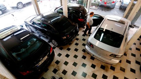 An Iranian man looks at cars displayed in a showroom in the capital Tehran on August 6, 2018. - Iran dismissed a US offer to renegotiate a historic 2015 nuclear deal signed with other major powers as President Donald Trump reimposed crippling sanctions on August 7. (Photo by ATTA KENARE / AFP)        (Photo credit should read ATTA KENARE/AFP/Getty Images)
