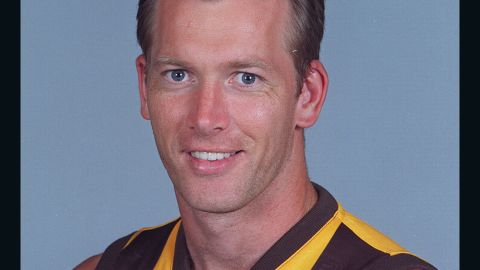 Nathan Chapman, shown posing for the Hawthorn Hawks in 2000, played Australian rules football for eight years before trying out for the NFL.