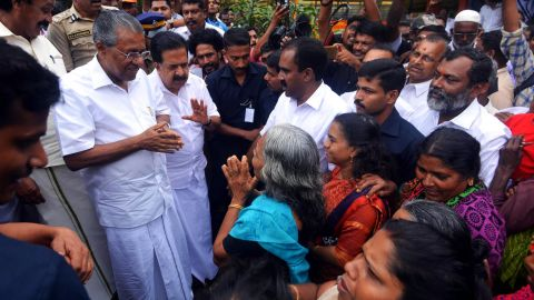 Kerala Chief Minister Pinarayi Vijayan (left) visits a relief camp in the Indian state of Kerala on August 11.