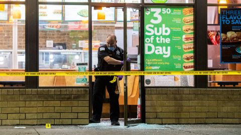 A Chicago police officer investigates the scene of a shooting on Saturday.