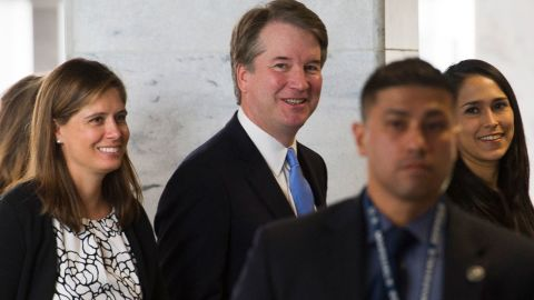 Supreme Court nominee Brett Kavanaugh walks to the office of Sen. Joe Donnelly, D-Ind., for a meeting on Capitol Hill in Washington, Wednesday, Aug. 15, 2018. (AP Photo/Cliff Owen)