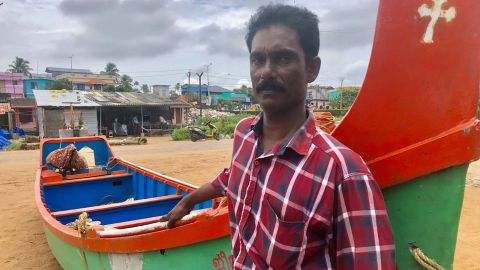 Fisherman Marion George says Hindu Brahmin flood victims would only let him rescue them if he did not touch them.