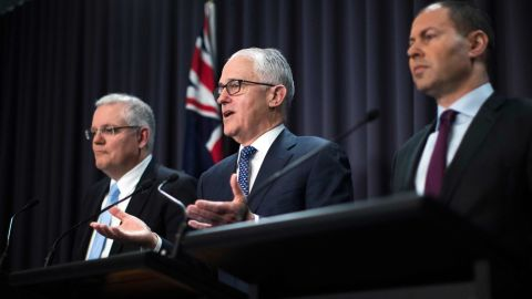 Malcolm Turnbull (center) speaks at a press conference with Treasurer Scott Morrison and Minister for Environment and Energy Josh Frydenberg on August 20.