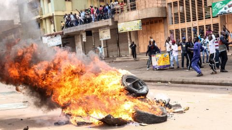 Protesters set a bonfire on a street to demand the release of the Ugandan politician Robert Kyagulanyi in Kampala, Uganda, on Monday.