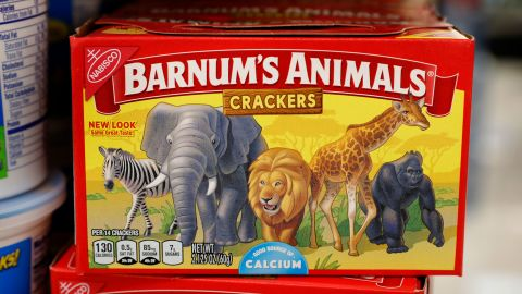The redesigned Barnum's Animals crackers show a zebra, elephant, lion, giraffe and gorilla wandering side-by-side in a grassland.