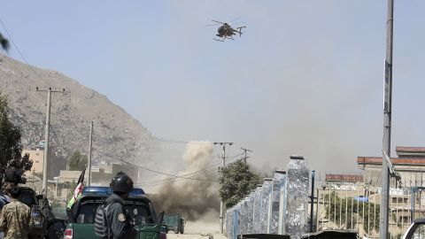 An MD 530F military helicopter targets a house where suspected attackers are hiding in Kabul, Afghanistan, Tuesday, Aug. 21, 2018.