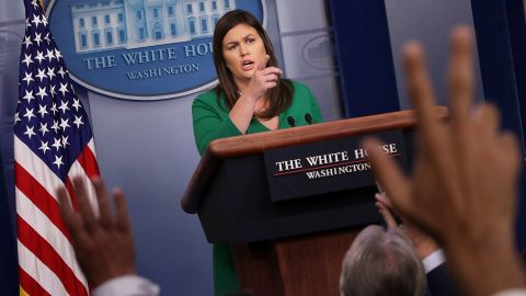 White House Press Secretary Sarah Huckabee Sanders called on reporters during a news conference in the Brady Press Briefing Room at the White House August 15, 2018 in Washington, DC. Sanders announced that President Donald Trump revolked former CIA Director John Brennan's security clearance.  (Chip Somodevilla/Getty Images)